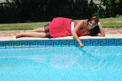 Young Woman At Poolside Stock Images