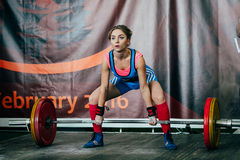 Young woman athlete performs deadlift barbell Royalty Free Stock Image