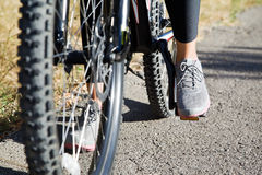 Young woman athletic on a mountain bike. Stopped to rest Stock Photo