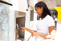 Young woman at the ATM. Young woman at the cash machine Stock Photo