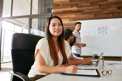 Young woman attending a business presentation Royalty Free Stock Photography