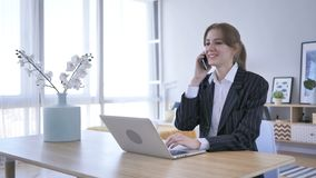 Young Woman Attending Call at Work, Talking on Phone. 4k , high quality stock video footage