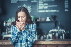 Young woman. Attractive girl drinking coffee indoors Royalty Free Stock Images