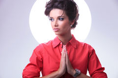 Young woman with aura prays and looks away Stock Images