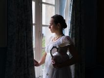 Vintage lady at the window royalty free stock images