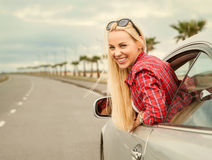 Young woman auto traveler on the highway Stock Image