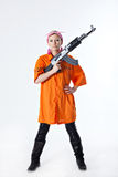 Young woman with automatic rifle. Dangerous young woman in orange shirt holding automatic rifle Stock Photos