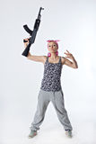 Young woman with automatic rifle. Dangerous young woman holding automatic rifle Royalty Free Stock Image