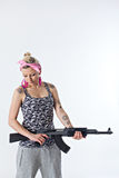 Young woman with automatic rifle. Dangerous young woman holding automatic rifle Royalty Free Stock Photo
