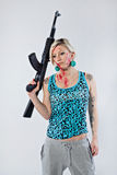 Young woman with automatic rifle. Dangerous young woman holding automatic rifle Stock Photography