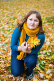 Young woman on a autumn day Stock Photos
