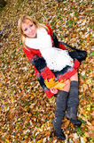 Young woman in autumn forest Royalty Free Stock Photography
