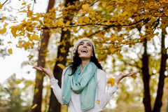 Young woman in the autumn forest Stock Image