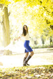 Young woman in autumn forest Royalty Free Stock Photo