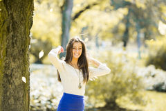 Young woman in autumn forest Royalty Free Stock Image