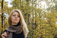 Young woman in autumn forest. Portrait of young woman in autumn forest with copy-space stock photography