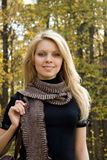 Young woman in autumn forest. Portrait of young smiling woman in autumn forest stock image