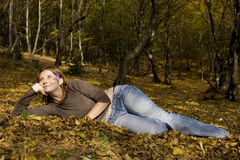 Young woman in autumn forest. Young woman laying in autumn forest Stock Photos