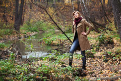 Young woman in autumn forest Stock Image