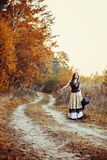Young woman in the autumn forest Stock Images