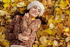 Young woman at autumn forest Stock Photos