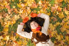 Young woman on the autumn leaf Royalty Free Stock Photo