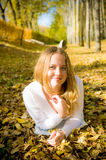 Young woman on the autumn leaf. Young pretty woman on the autumn leaf Royalty Free Stock Images
