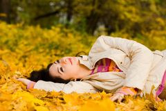 Young woman on the autumn leaf Stock Photos