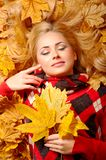 Young woman with autumn leaves. Young smiling woman with autumn leaves stock photo
