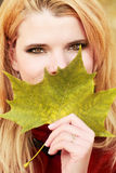 Young woman with autumn leaves Royalty Free Stock Images