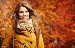 Young woman with autumn leaves Royalty Free Stock Photography