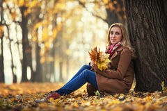 Young woman with autumn leaves Royalty Free Stock Photo