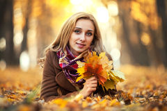 Young woman with autumn leaves Stock Photo
