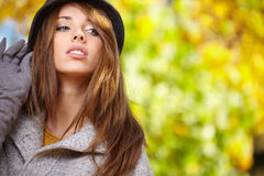 Young woman with autumn leaves. In hand and fall yellow maple garden background royalty free stock photo