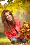 Young woman with autumn leaves Stock Image