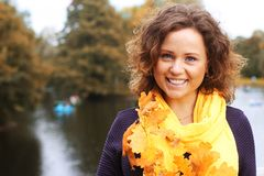 Young woman with autumn leaves in park Royalty Free Stock Photo