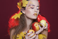 Young woman with autumn make up and leaves on head. Young beautiful woman with autumn make up and leaves on head stock images