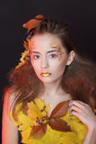 Young woman with autumn make up and leaves on head. Young beautiful woman with autumn make up and leaves on head royalty free stock photos
