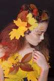 Young woman with autumn make up and leaves on head. Young beautiful woman with autumn make up and leaves on head stock photography