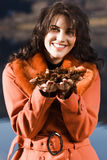 Young woman with autumn mood. Young woman blowing leaves from your hand stock photos