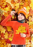 Young woman in autumn orange leaves. Outdoor stock photo