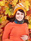 Young woman in autumn orange leaves. Stock Photography