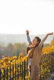 Young woman in autumn outdoors rejoicing Royalty Free Stock Photos