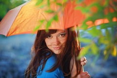 Young woman in autumn park. Portrait of beautiful female with umbrella in autumn park stock photo