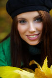 Young woman in autumn park. Royalty Free Stock Photos