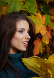 Young woman in autumn park. Royalty Free Stock Photo