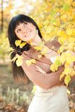 Young woman in the autumn park Stock Photo