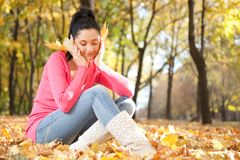 Young woman in the autumn park Royalty Free Stock Photography