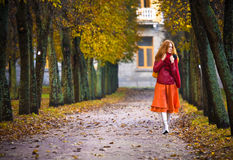 Young woman in autumn park. Young red hair woman in autumn park stock photos