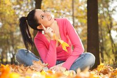 Young woman in the autumn park Royalty Free Stock Photos